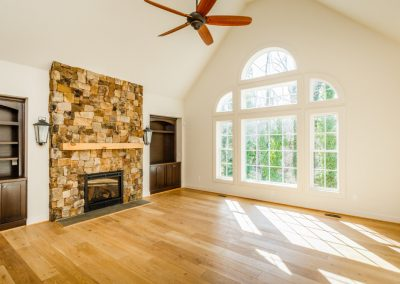R.E. Collier INC, Builder custom home with fireplace and built in shelves