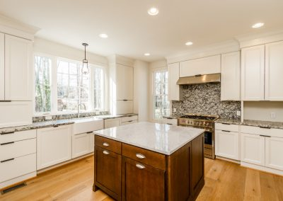 R.E. Collier INC, Builder custom kitchen with marble countertops