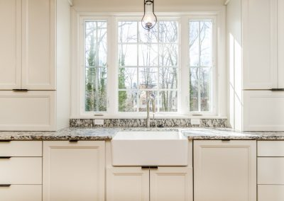 R.E. Collier INC, Builder custom home with farmhouse sink and marble countertops
