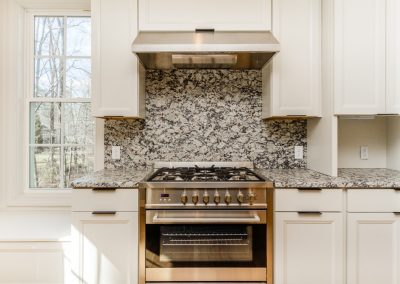 R.E. Collier INC, Builder custom home kitchen with marble back splash
