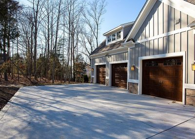 R.E. Collier INC, Builder custom home exterior three car garage